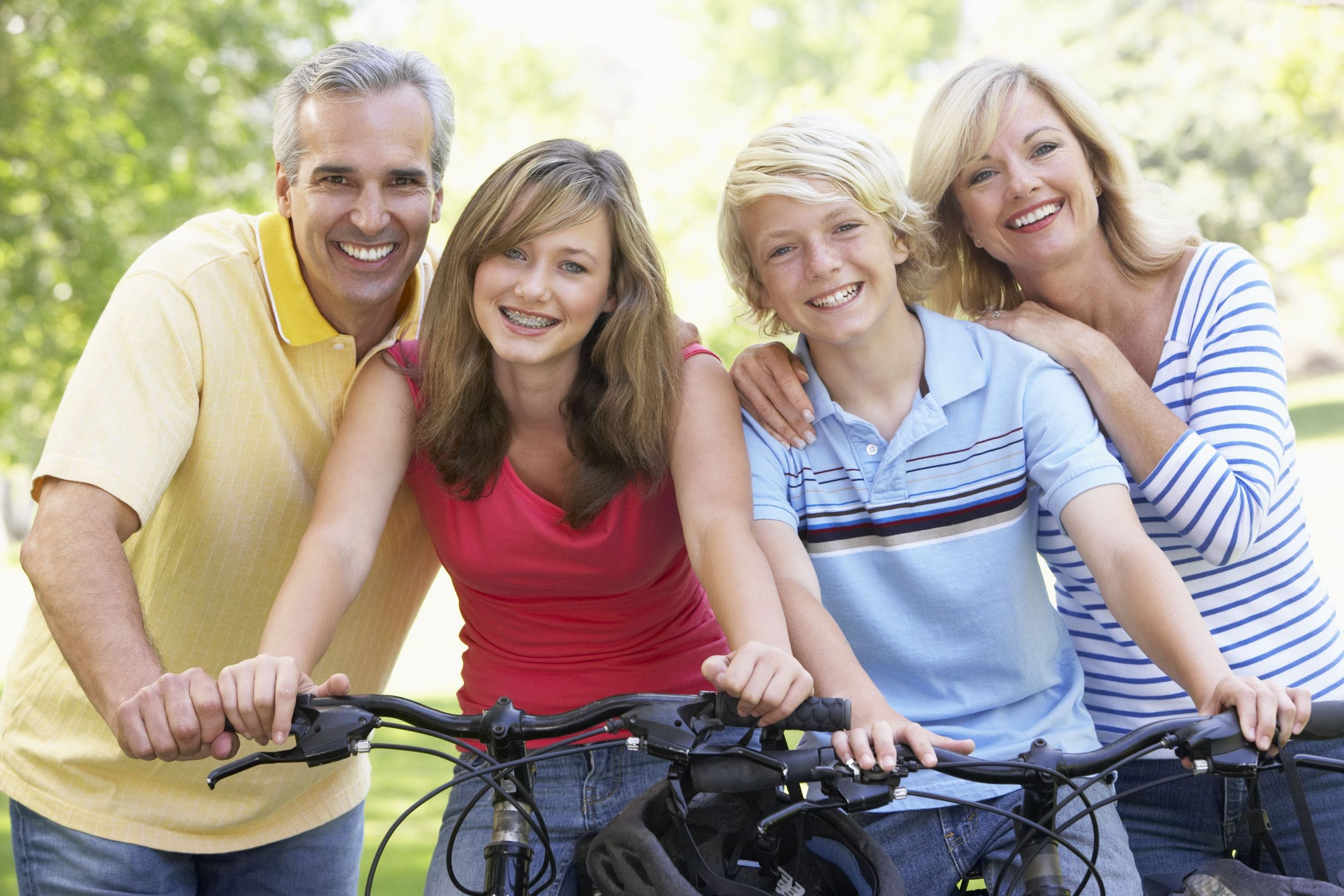 Family smiling and riding bikes